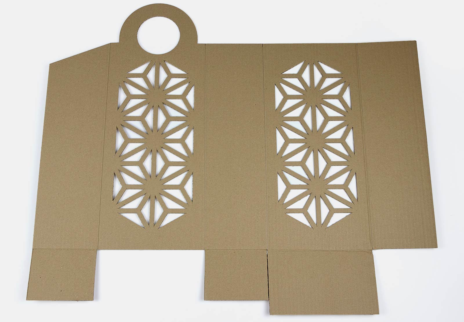 a shape of a catch-all box cut out of cardboard